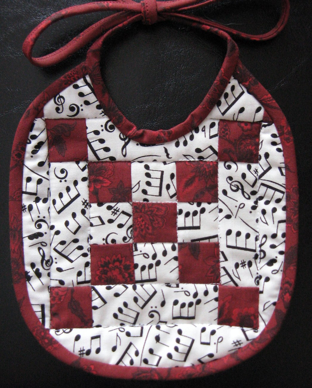 Nine-patch quilted baby bib
