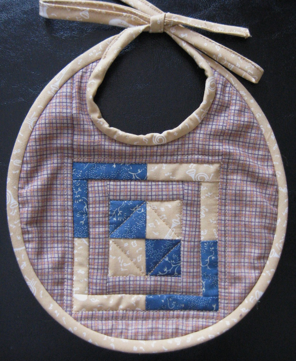Squares in a square quilted baby bib