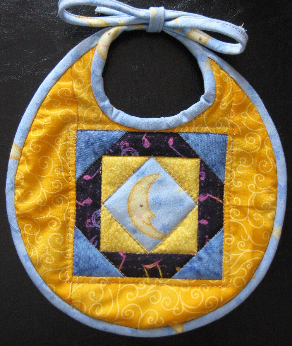 Fly Me to the Moon quilted baby bib